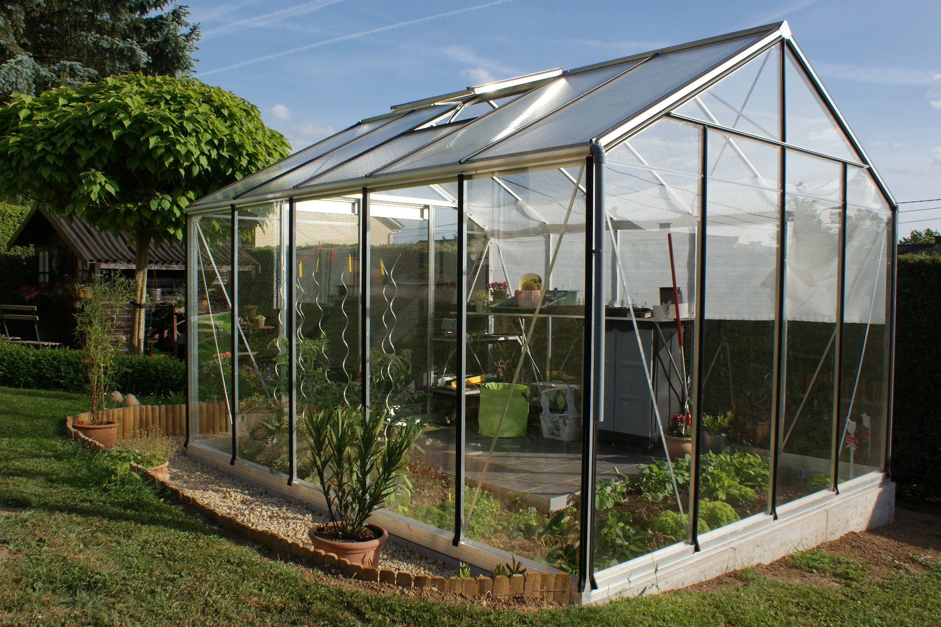 Conception et installation de serre de jardin et véranda